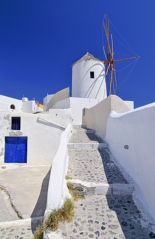 Paved path to a windmill in Oia, Ia, Santorini, Cyclades, Greece, Europe