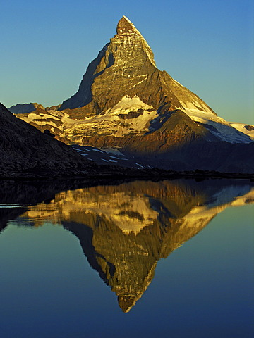 The Matterhorn is reflected in the Riffelsee near Zermatt, canton Wallis, Switzerland