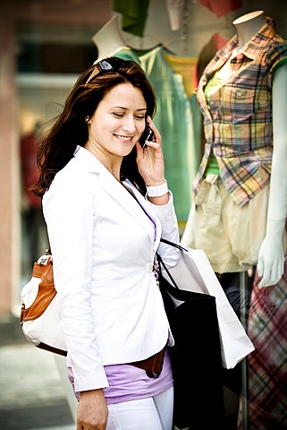 Young woman on a shopping expedition in the city