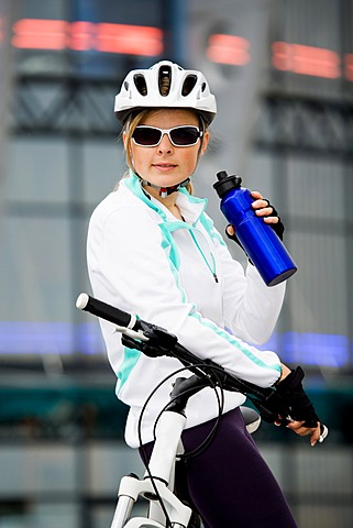 Female cyclist in urban surroundings