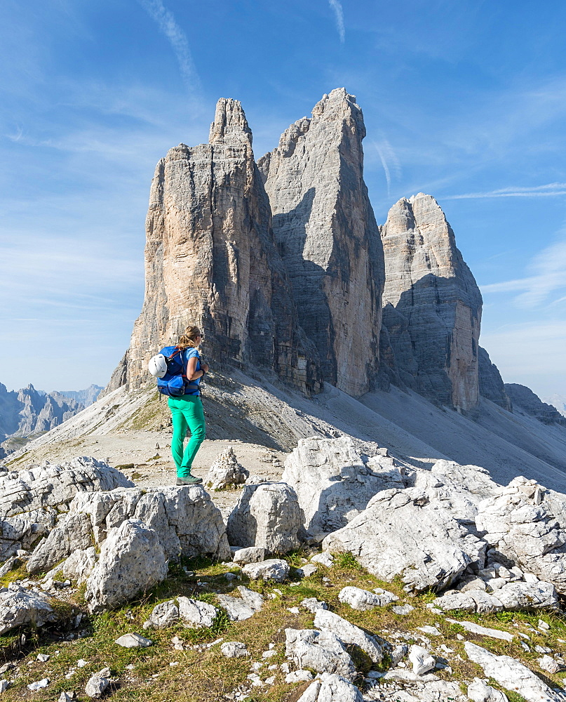 Hiker at the saddle of the Paternsattel, North faces of the Three Peaks, Sesto Dolomites, South Tyrol, Trentino-South Tyrol, Alto-Adige, Italy, Europe