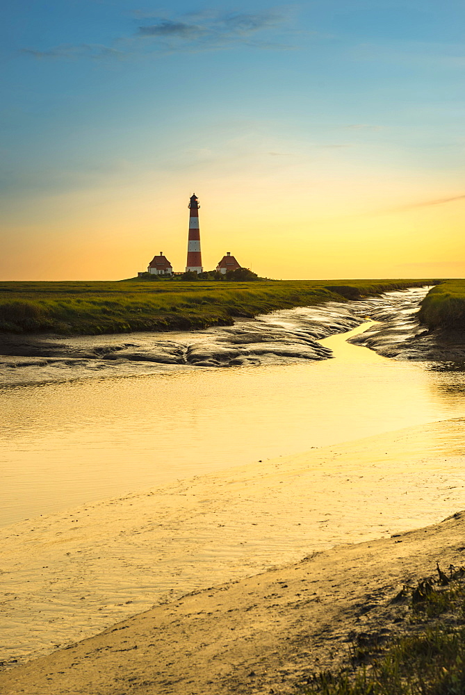 Creek in the salt marshes in front of Westerhever Lighthouse in the evening sun, Westerhever, Eiderstedt, North Frisia, Schleswig-Holstein, Germany, Europe