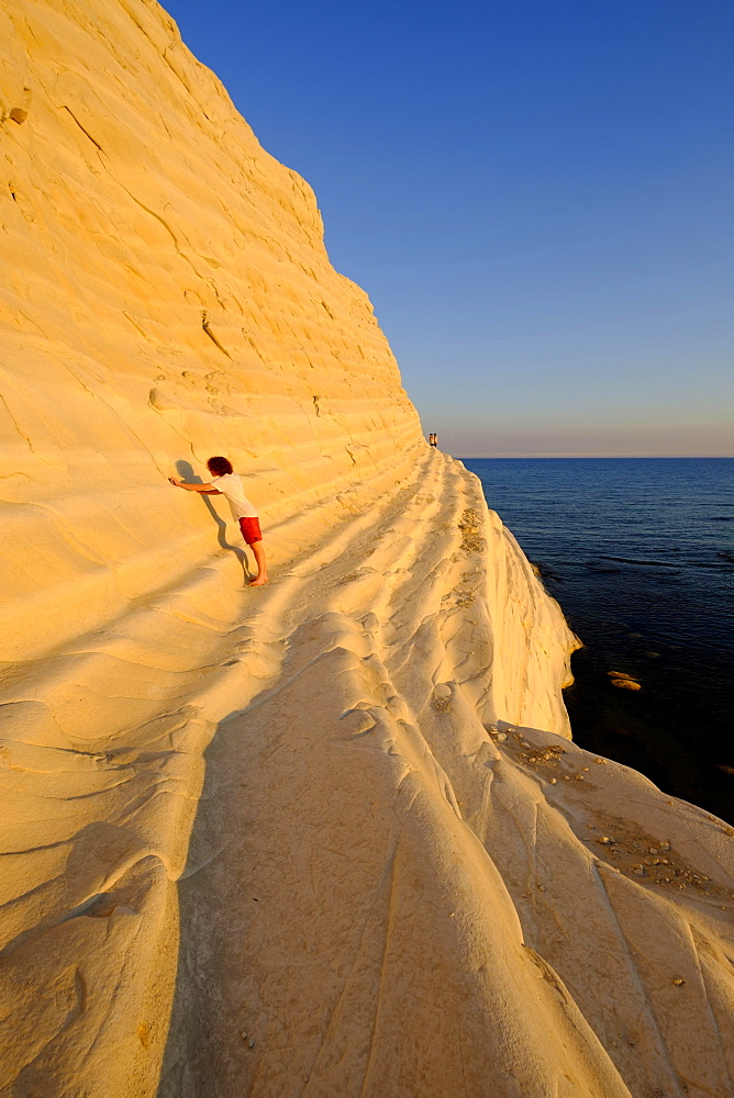 Sunset, rocky coast of Scala dei Turchi, limestone rocks, Realmonte, Province of Agrigento, Sicily, Italy, Europe