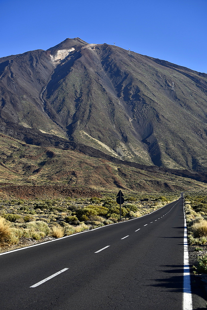 Street TF21 through volcanic landscape with volcano Teide, Teide National Park, Tenerife, Canary Islands, Spain, Europe