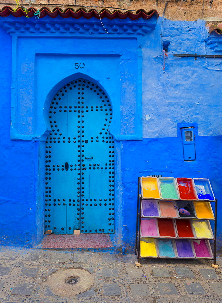 Blue front door, next to color pigments, house facade, blue painted house, medina of Chefchaouen, Chaouen, Tanger-Tétouan, Kingdom of Morocco