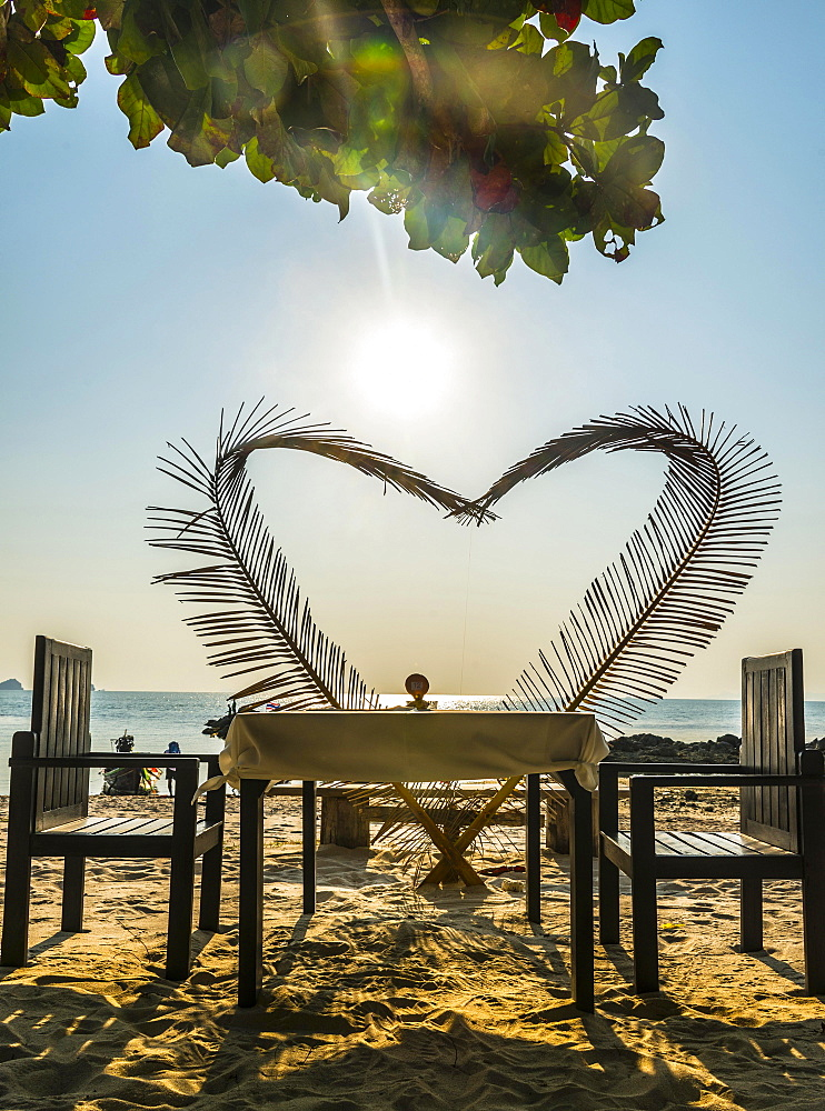 Laid table with a heart of palm fronds, sunset, Koh Samui, Gulf of Thailand, Thailand, Asia - 832-381266