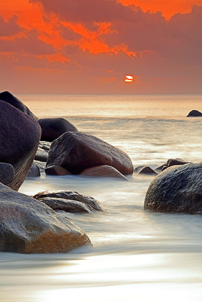 Spectacular sunset at Anse Lazio, long exposure, Praslin Island, Seychelles, Africa