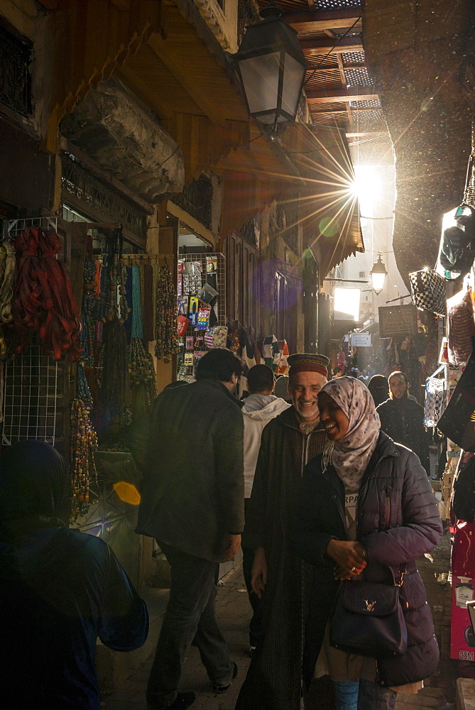 Locals, Narrow streets in an Arab market, Shouk, Fez Medina, Fes, Morocco, Africa