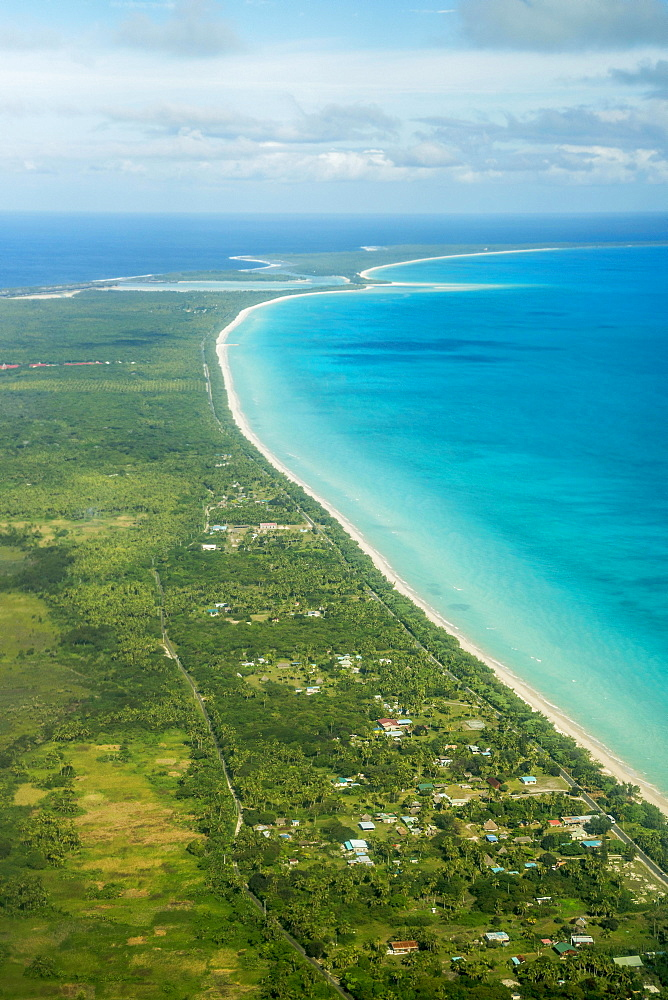 Coastline with beach and village, Ouvea island, New Caledonia, Oceania