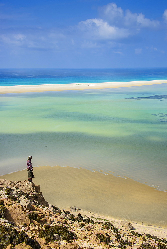 Yemenite man overlooking the Detwah lagoon, near Qalansia, Socotra, Yemen, Asia