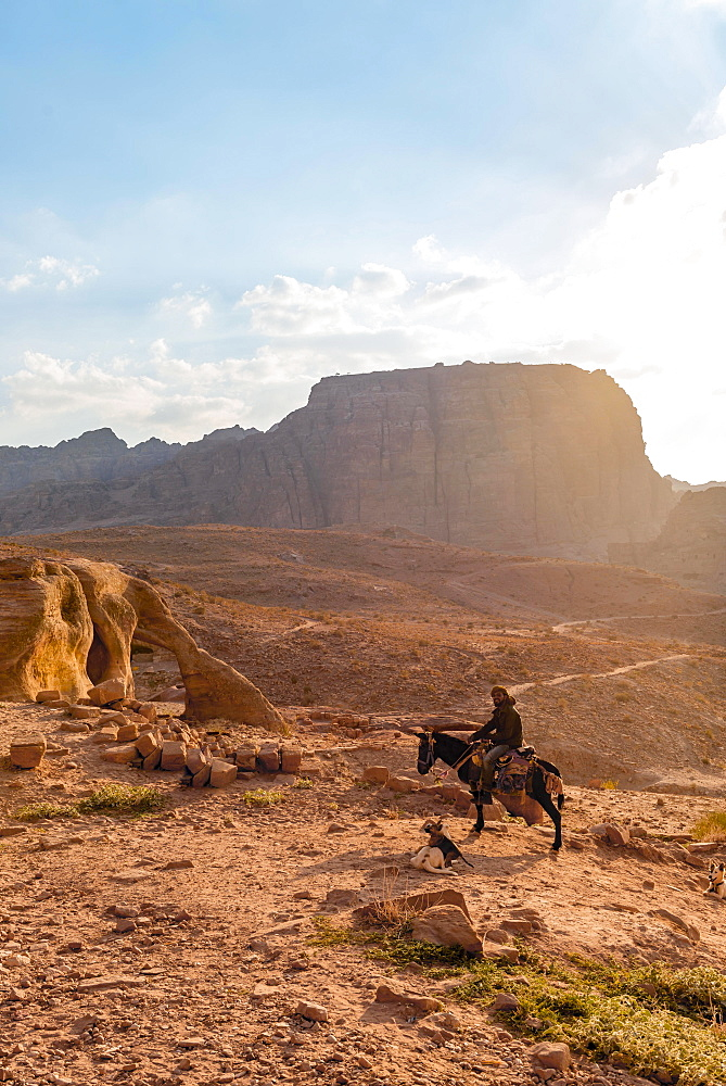 Man on a donkey, Nabataean city Petra, near Wadi Musa, Jordan, Asia