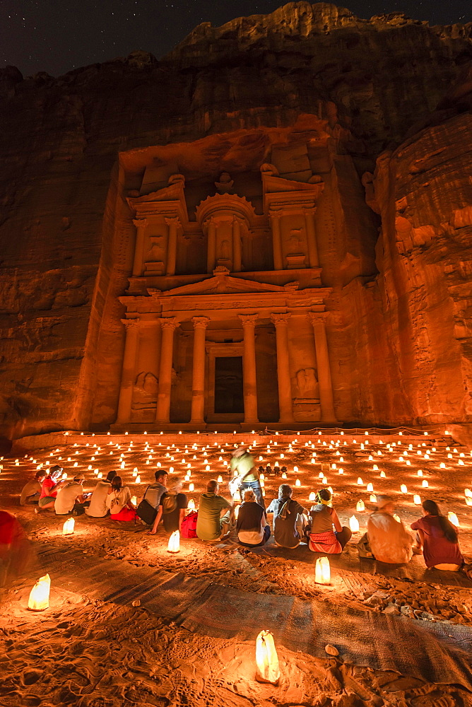 People sitting in front of candles, Pharaoh's treasure house beaten into rock at night, facade of the treasure house Al-Khazneh, Khazne Faraun, mausoleum in the Nabataean city of Petra, near Wadi Musa, Jordan, Asia