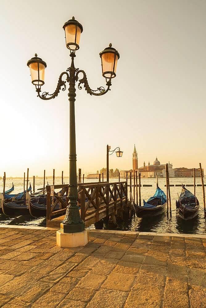 Lamppost with gondolas in San Marco and Benedictine church of San Giorgio Maggiore on San Giorgio Maggiore island, Venice, Veneto, Italy, Europe
