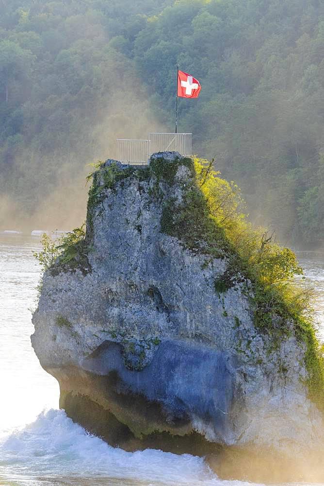 Vantage point, rock at the Rhine Falls with Swiss flag, Schaffhausen, Switzerland, Europe