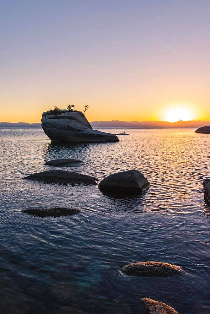 Bonsai Rock, small tree on a rock in the water, sunset, Lake Tahoe, California, USA, North America