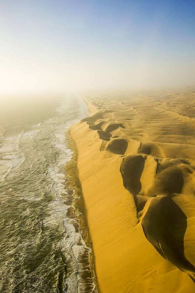 Aerial view, sandunes of the Namib desert floating in the Atlantic ocean, Namibia, Africa