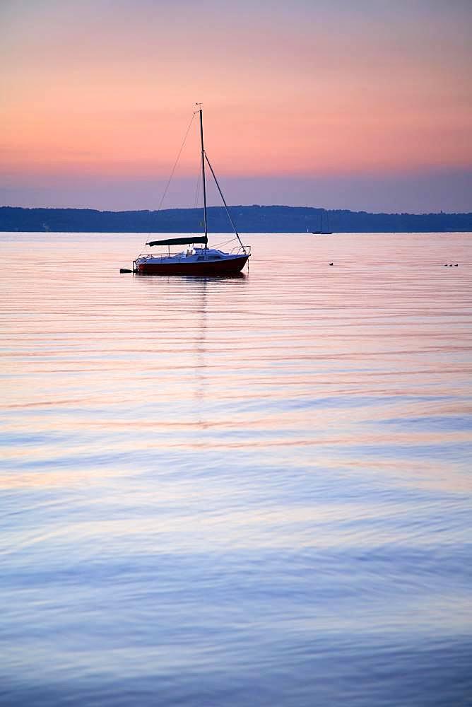 Evening mood, sailboat anchoring in Lake Starnberg, Bavaria, Upper Bavaria, Germany, Europe