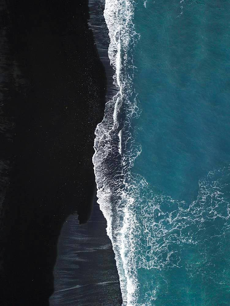 Black volcanic beach with waves running out from above, black sand, drone shot, Lanzarote, Spain, Europe