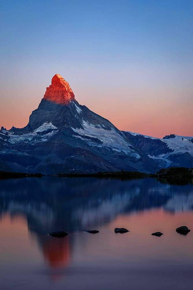 Matterhorn at sunrise reflected in the Stellisee, Zermatt, Valais, Switzerland, Europe