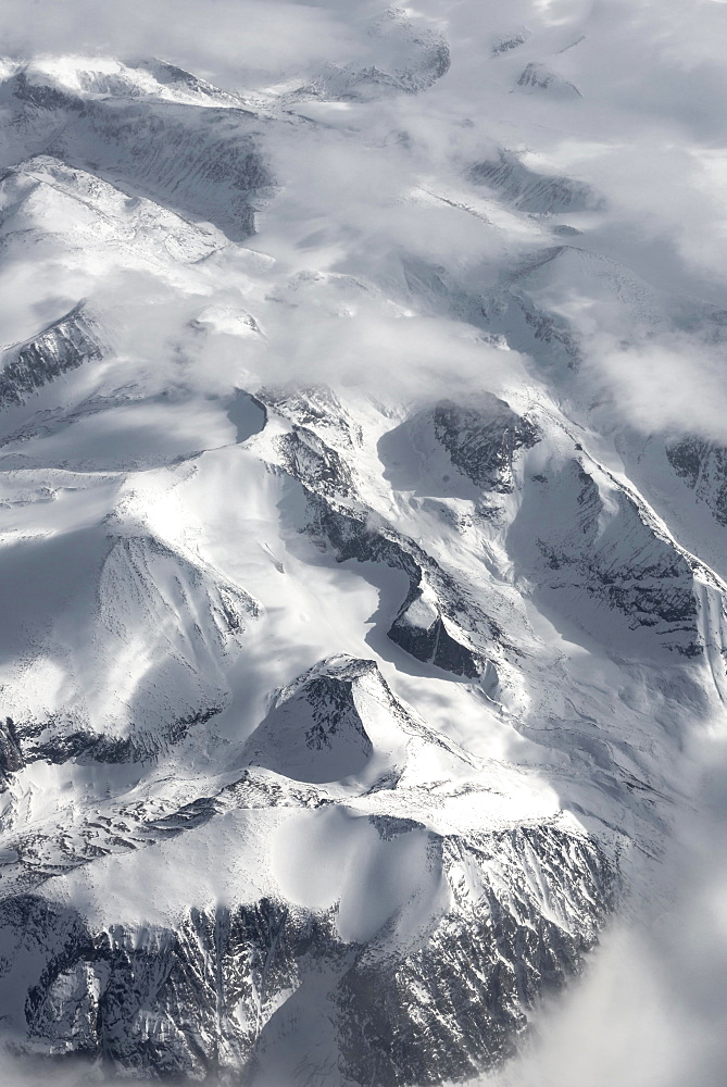 View from the plane to snow-covered mountainous landscape, bird's eye view, Greenland, North America