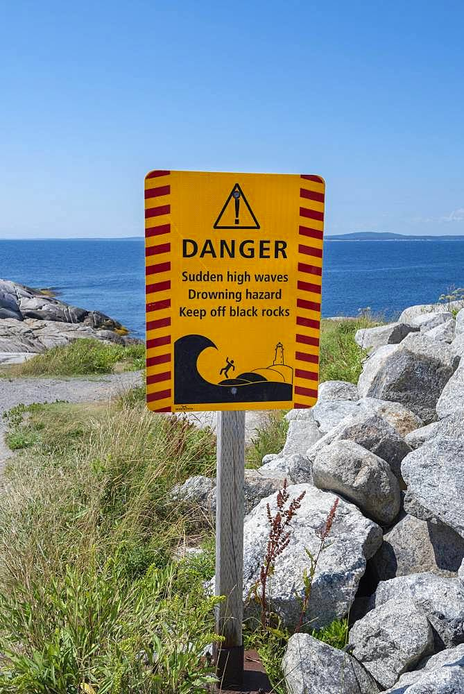 Warning sign for dangerous surf, Peggy's Cove, Nova Scotia, Canada, North America