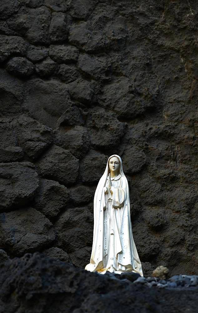 Madonna figure in volcanic rock, Ribeira de Janela, also Ribeira da Janela, Porto Moniz, Island Madeira, Portugal, Europe