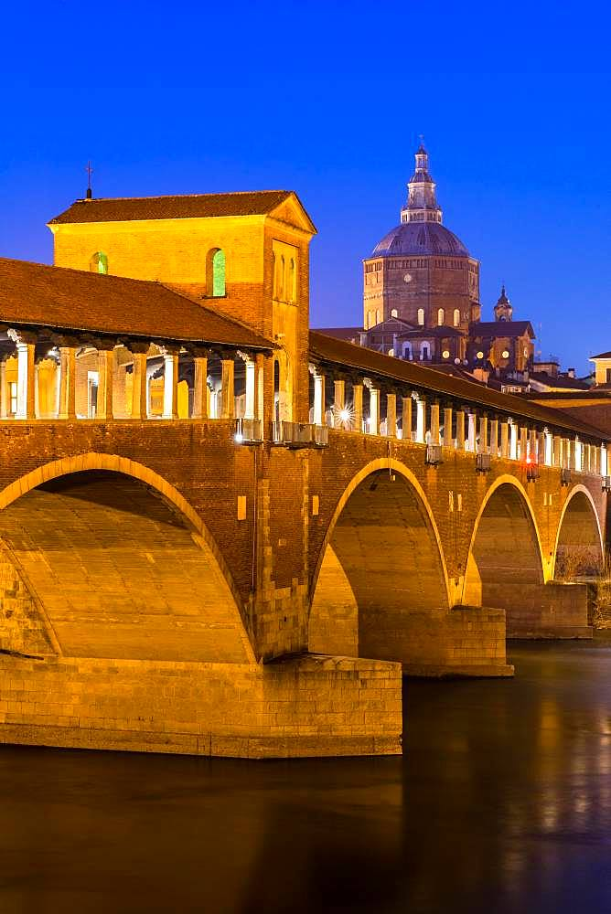 Illuminated bridge Ponte Coperto leads over the river Ticino with cathedral, dusk, Pavia, Lombardy, Italy, Europe