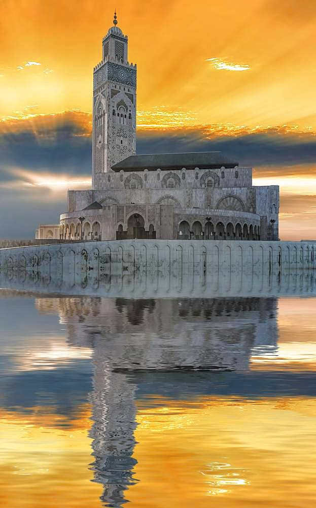Atmospheric sunset with reflection in the water, Mosque Hassan II, Casablanca, Morocco, Africa