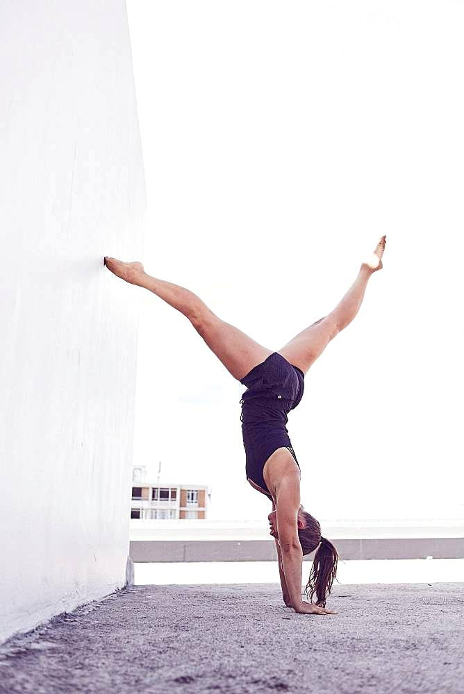 Young woman in swimsuit, handstand, gymnastics, Cape Town, South Africa, Africa
