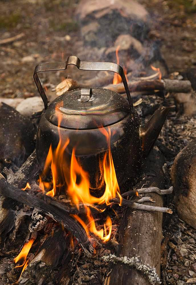 Large sooty coffee kettle on campfire, Haerjedalen, Sweden, Europe