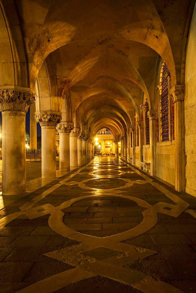 Colonnade of Doge's Palace (Palazzo Ducale) at night, Piazetta San Marco, Venice, Veneto, Italy, Europe