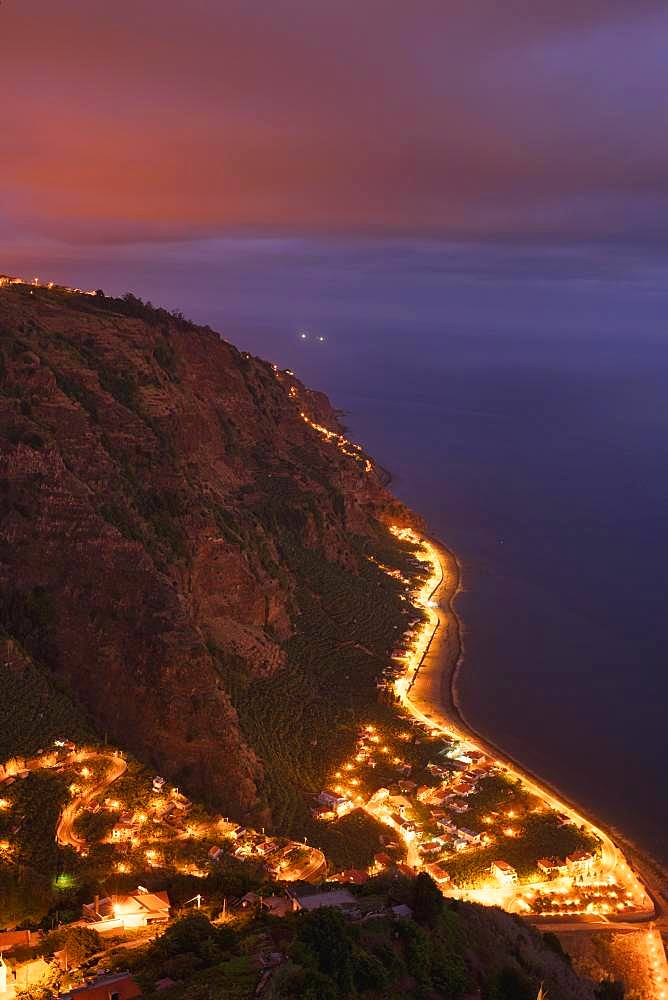 Night shot, view of illuminated place Arco da Calheta at the steep coast, Madeira, Portugal, Europe