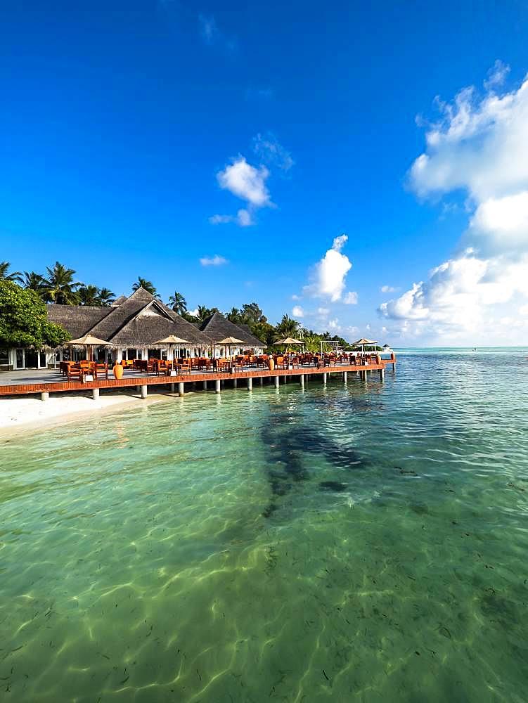 Tourist Resort, Bungalows between palm trees, Maldives Island, South Male Atoll, Maldives, Asia