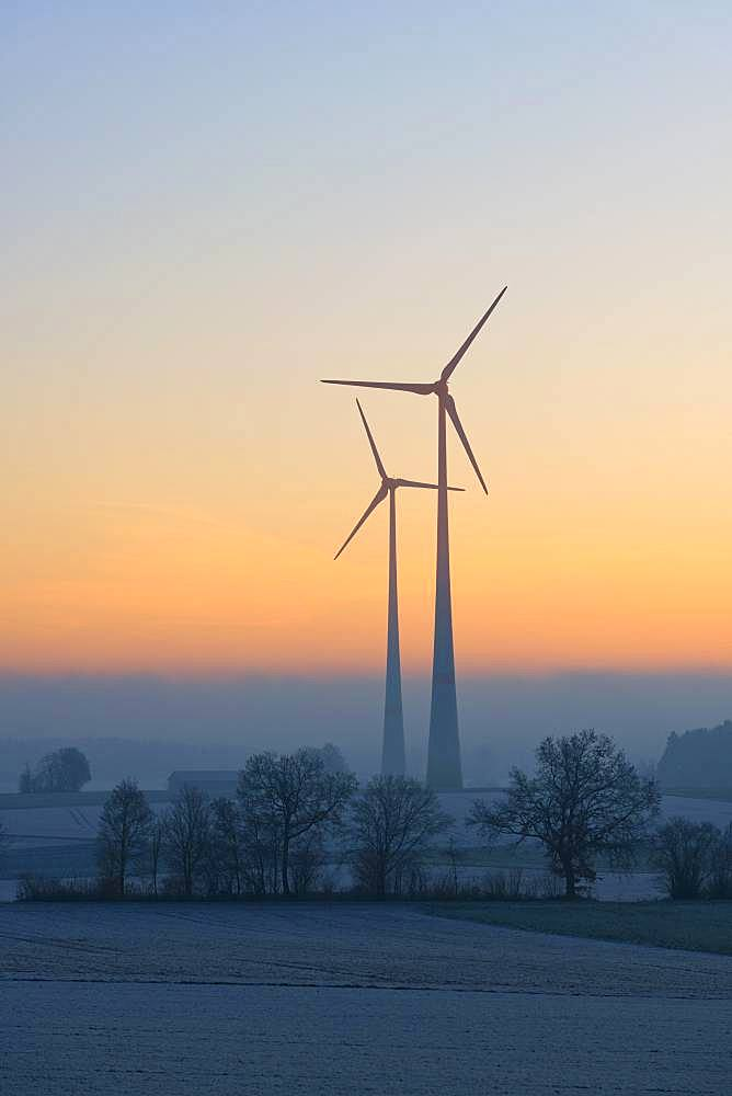 Wind power plants, silhouettes in dawn, Swabian Alb, Baden-Wuerttemberg, Germany, Europe