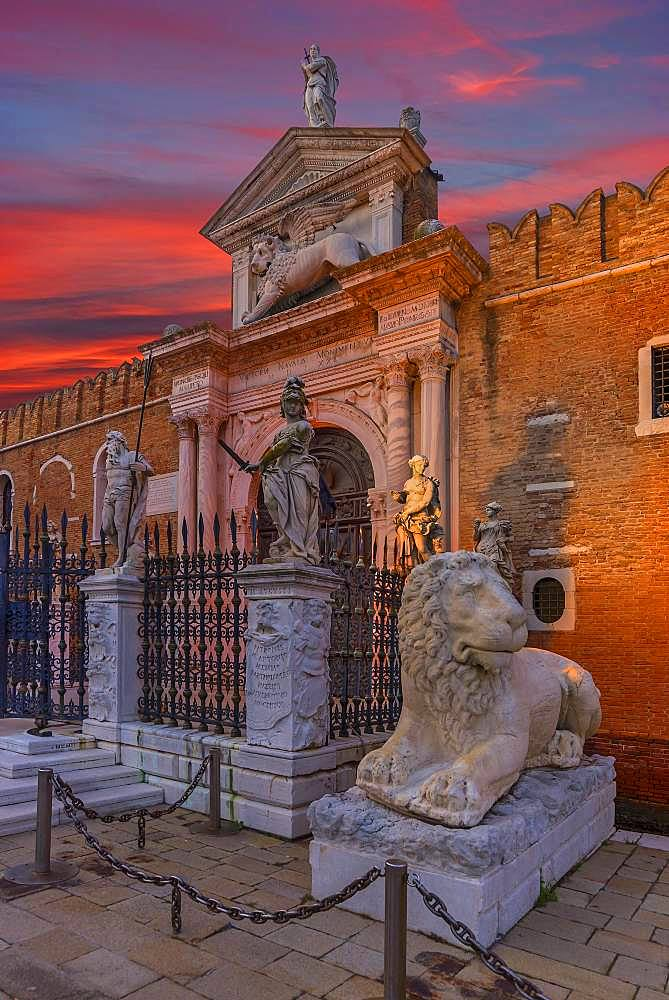 Renaissance entrance portal of the Arsenal, red evening sky, Venice, Veneto, Italy, Europe
