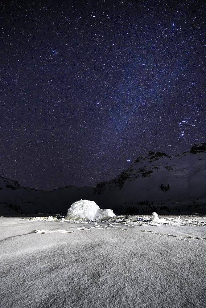 Igloo, Starry sky with milky way in the mountains in winter, Wattentaler Lizum, Tuxer Alps, Tyrol, Austria, Europe