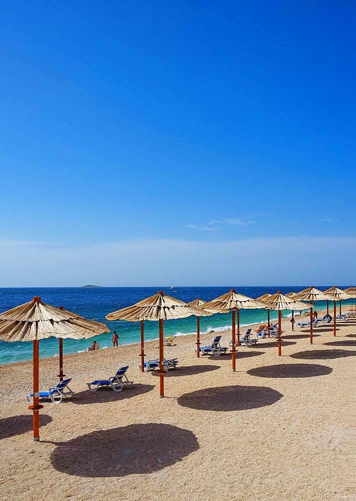 Beach with sunshades, Primosten, Croatia Adriatic coast, Central Dalmatia, Dalmatia, Croatia, Europe