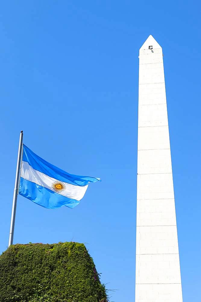 Obelisk and Argentinian flag on Avenue 9 de Julio, Buenos Aires, Argentina, South America