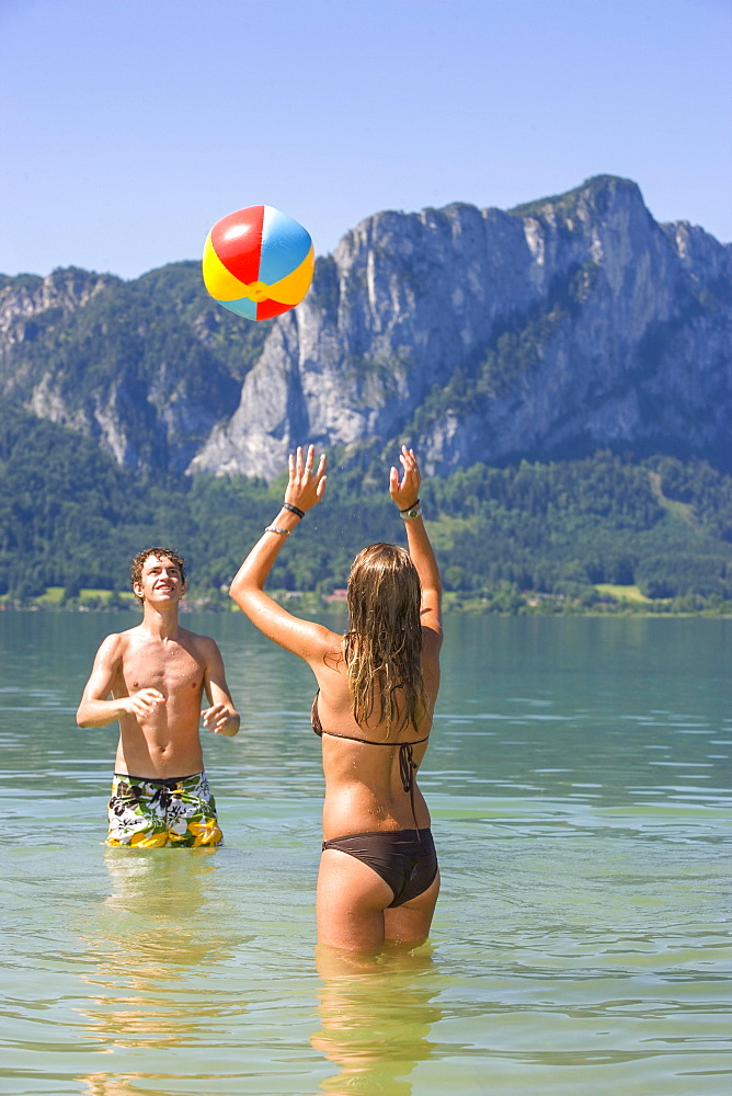 Two teenagers play with water polo in a lake, 18 years, Mondsee, Upper Austria, Austria, Europe
