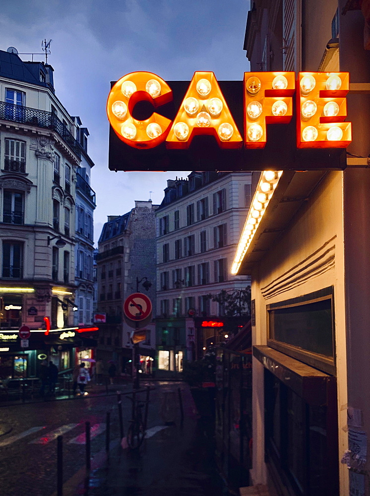 Illuminated advertising for a cafe, dusk, Montmartre, Paris, France, Europe