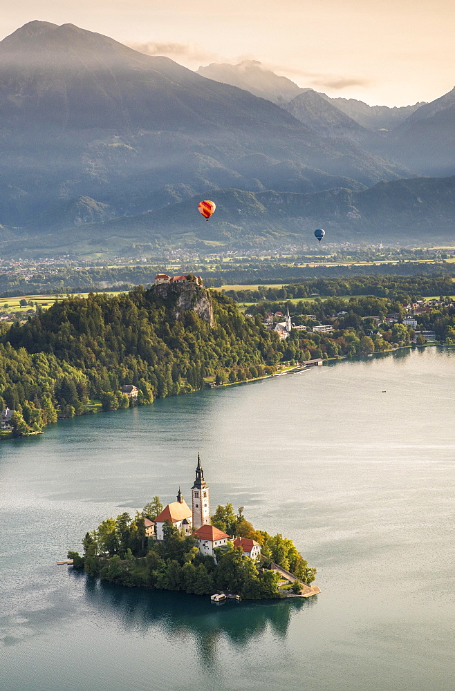 Lake Bled with Bled Castle and Blejski Otok Island with St. Mary's Church, behind it Karavanke, Bled, Slovenia, Europe