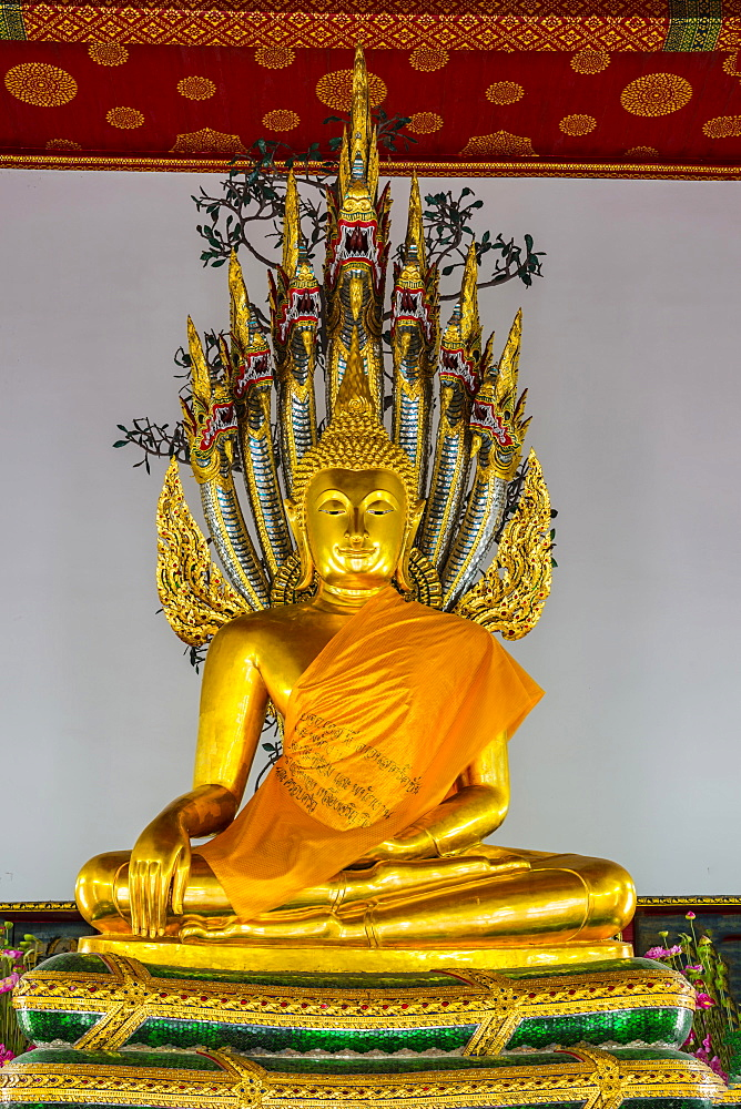 Buddha meditating under the protection of a seven-headed Naga snake, Wat Pho, Bangkok, Thailand, Asia