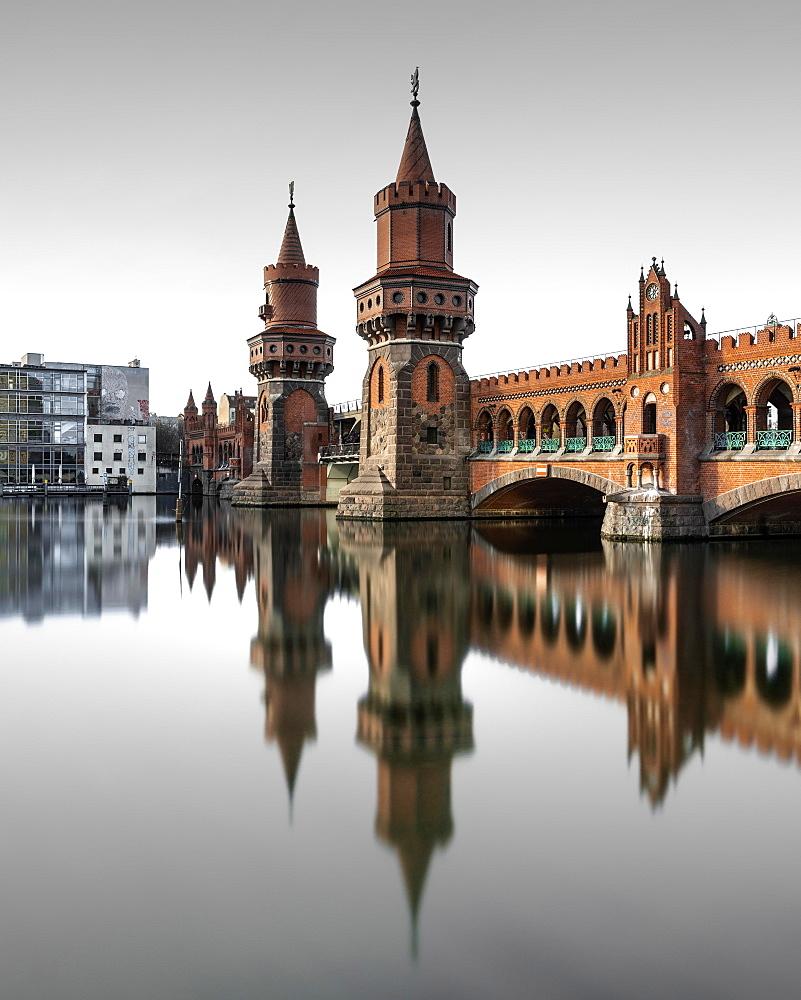 Berlin Oberbaum Bridge at Warschauer Strasse in Berlin with reflection in the Spree, Berlin, Germany, Europe - 832-388318