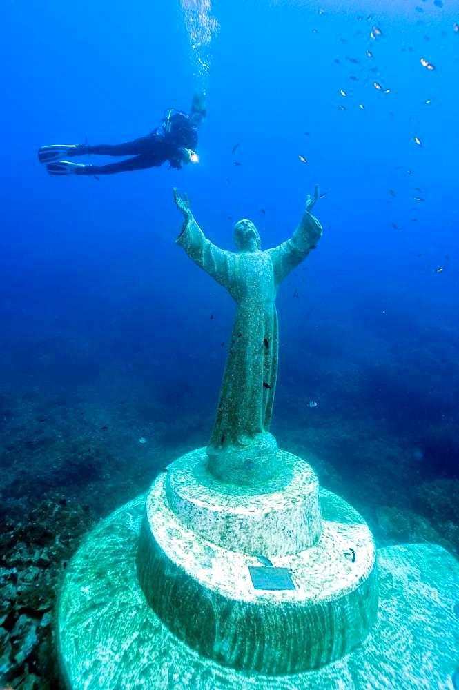 Diver at Christ statue under water, Mediterranean Sea, bay of San Fruttuoso, Portofino, Liguria, Italy, Europe