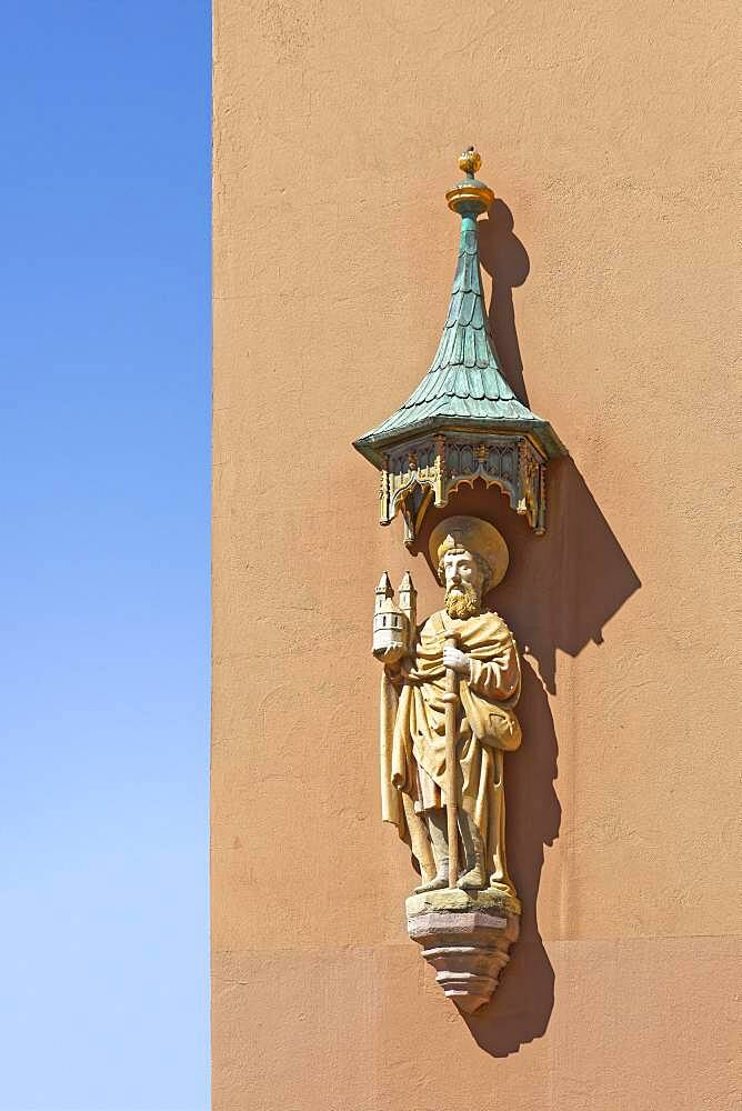 Saint Rochus of Montpelier, patron saint against plague, holding model of the church St. Sebald, statue under canopy made of copper with verdigris at the corner of the house Egidienplatz and Theresienplatz, Nuremberg, Middle Franconia, Franconia, Bavaria, Germany, Europe