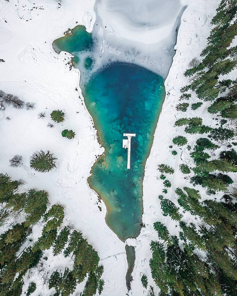 Aerial view, partly frozen Lake Cauma in winter, Grisons, Switzerland, Europe - 832-389116