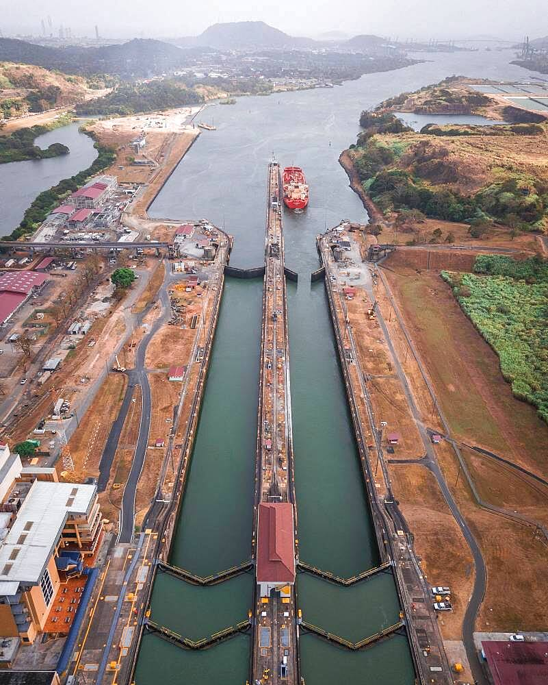 Aerial view, cargo ship at the lock in the Panama Canal from above, Mirador Miraflores, Panama, Central America - 832-389129