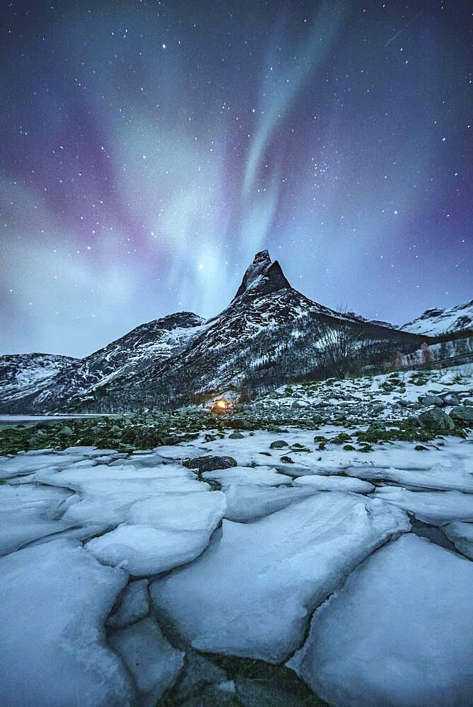 Mountain peak (Aurora borealis) Stetind, arctic winter landscape, night view, starry sky, northern lights Northern Lights, in front ice floes, Stetinden, Nordland, Norway, Europe - 832-389210