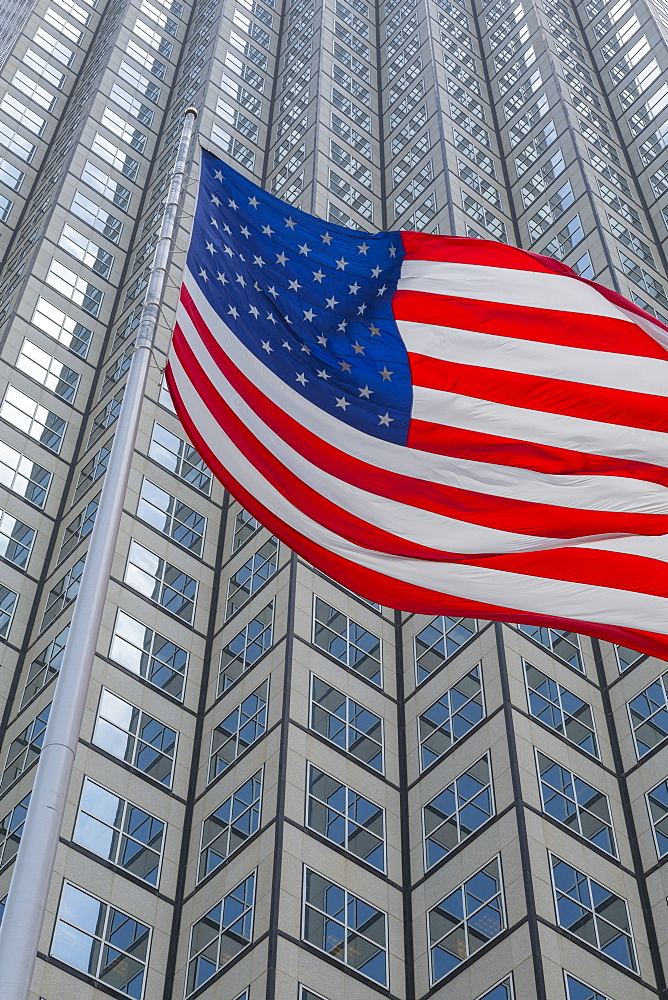 American flag set against skyscraper building windows in Downtown Miami, Miami, Florida, United States of America, North America