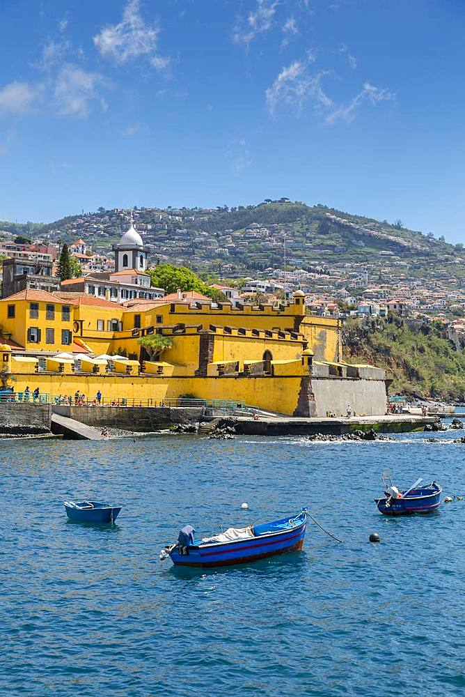 View of fishing boats in harbour and St. James Fort, Funchal, Madeira, Portugal, Atlantic, Europe